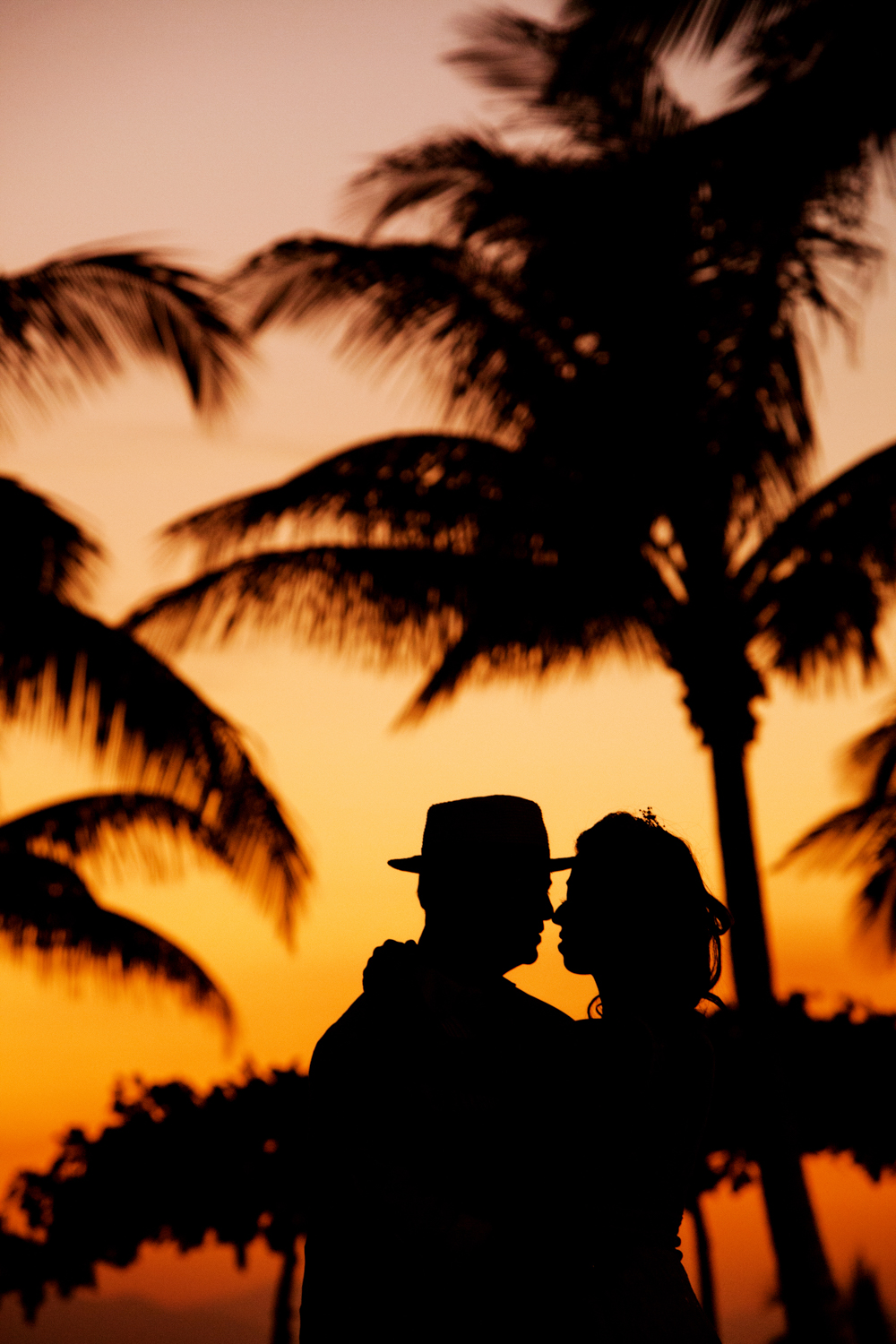 Couple in beach on sunset