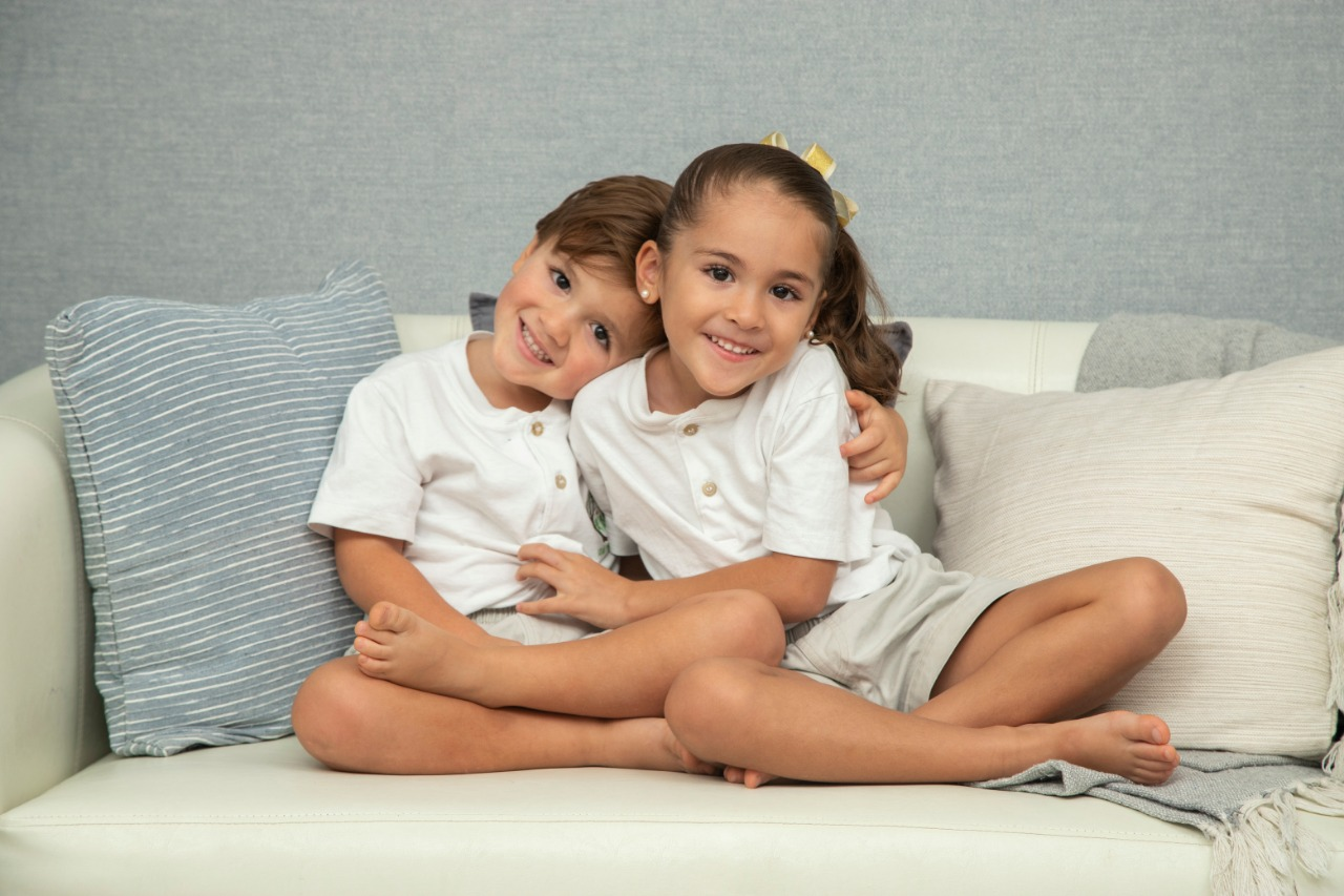 young siblings together on couch