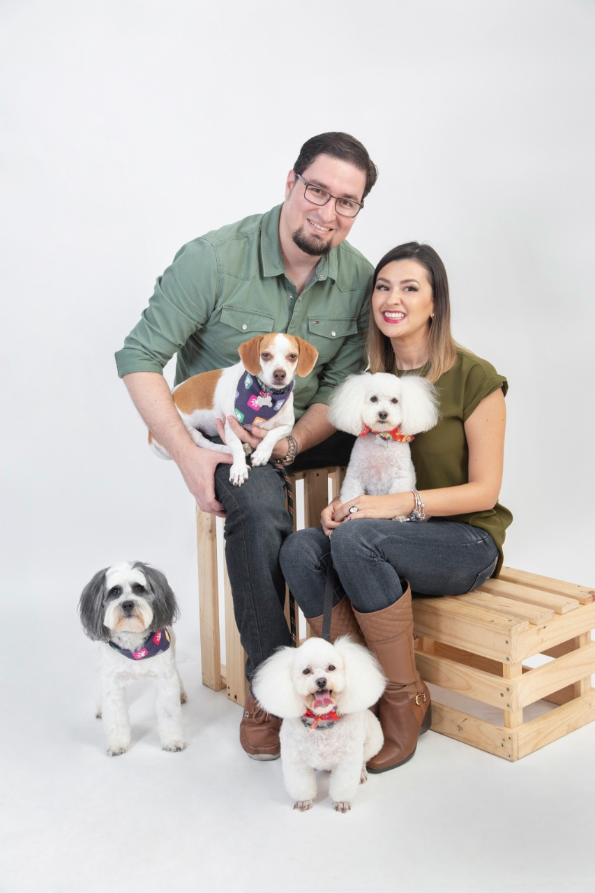 couple with 2 dogs on studio