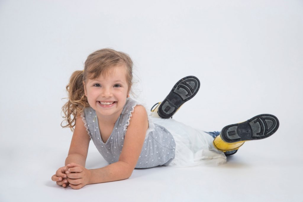 smiling girl feet up in the air