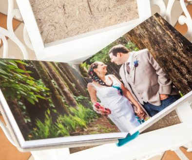 bride and groom on photo album