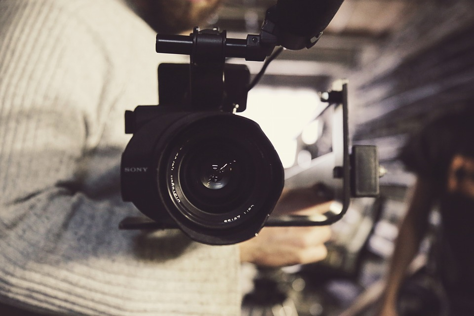 camera with lens on center