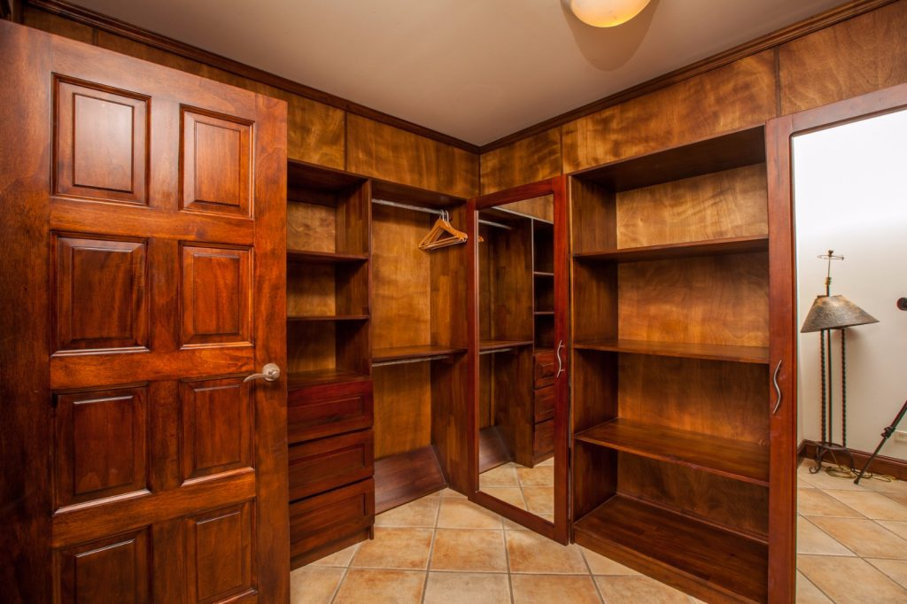 wooden walk in closet in full