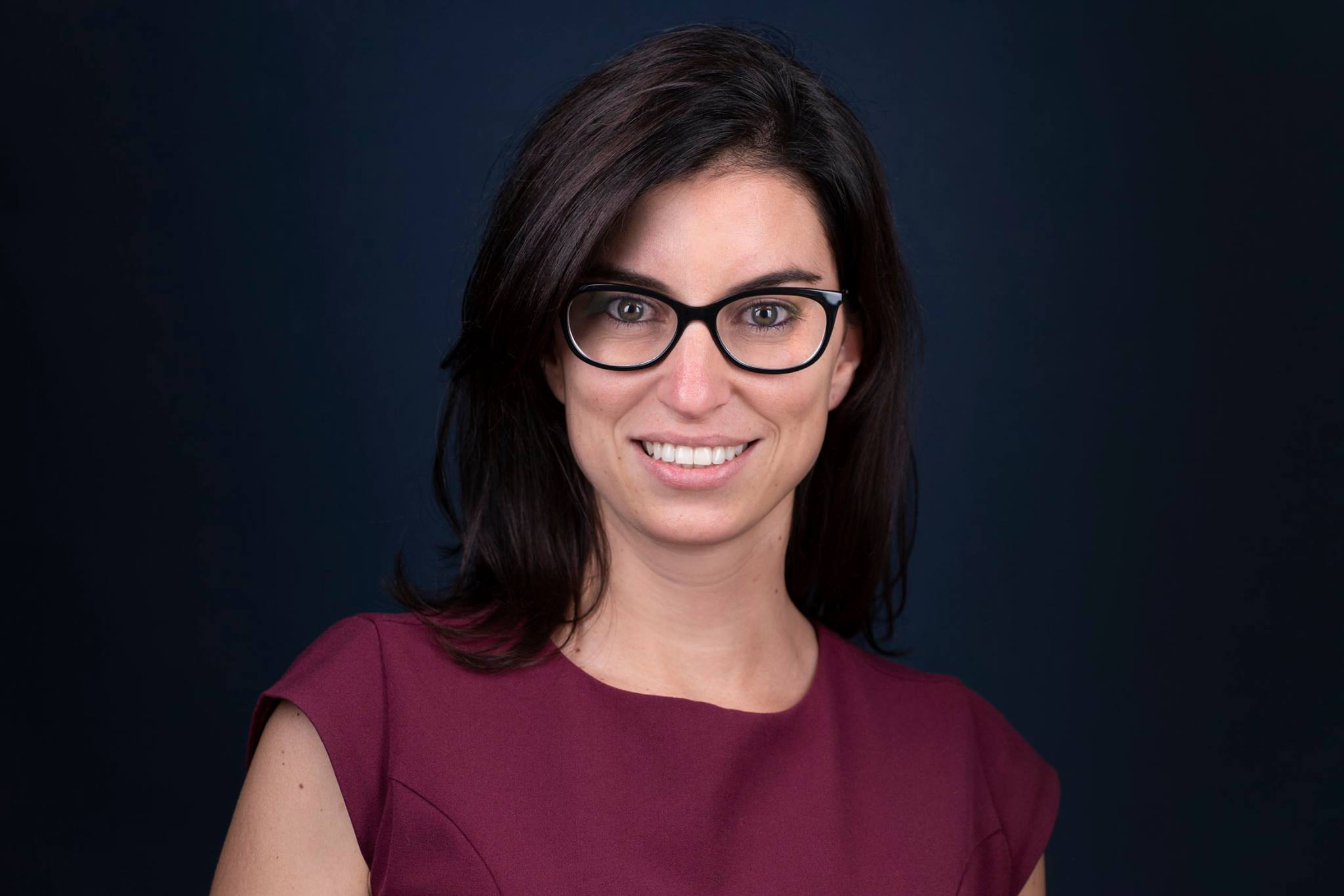 woman with glasses headshot